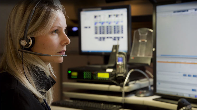 Female dispatcher uses I/CAD at a control center